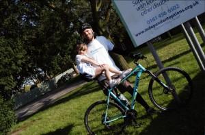 girl and man on bike