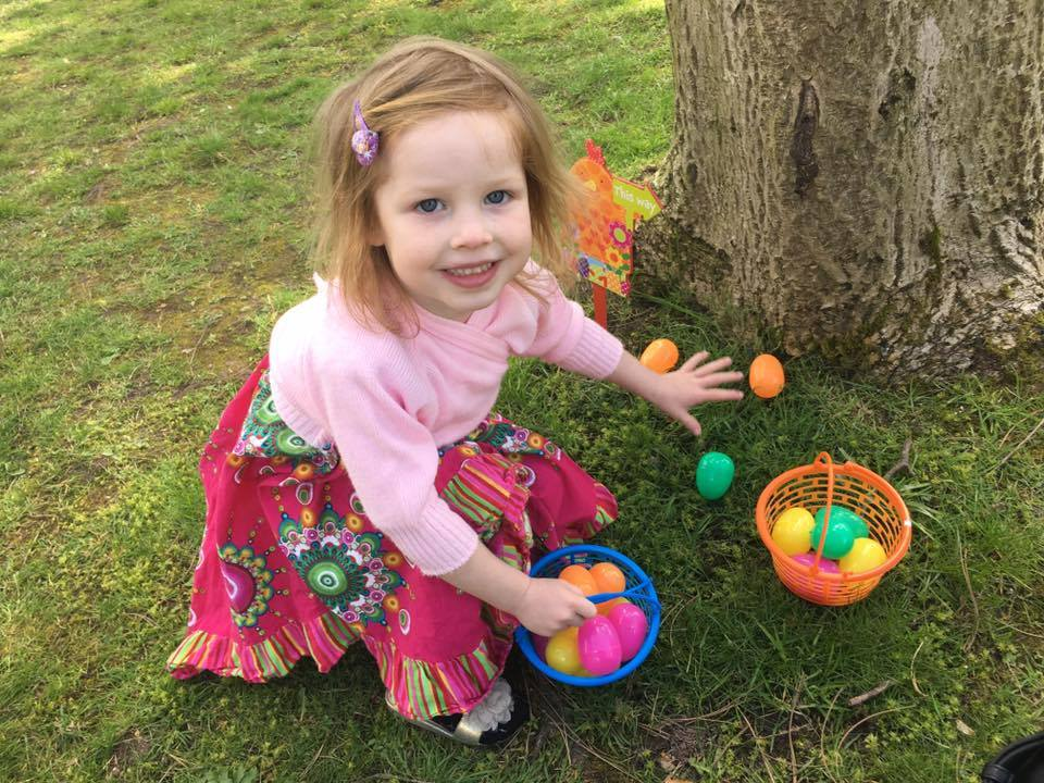 Chloe Holland, 4, collects easter eggs at Independent Options