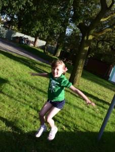 happy girl jumps bike