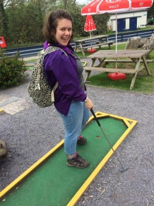 woman plays minigolf
