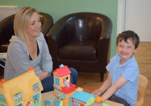 mum and son play with toys in centre