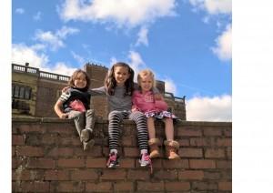 siblings climbing on wall